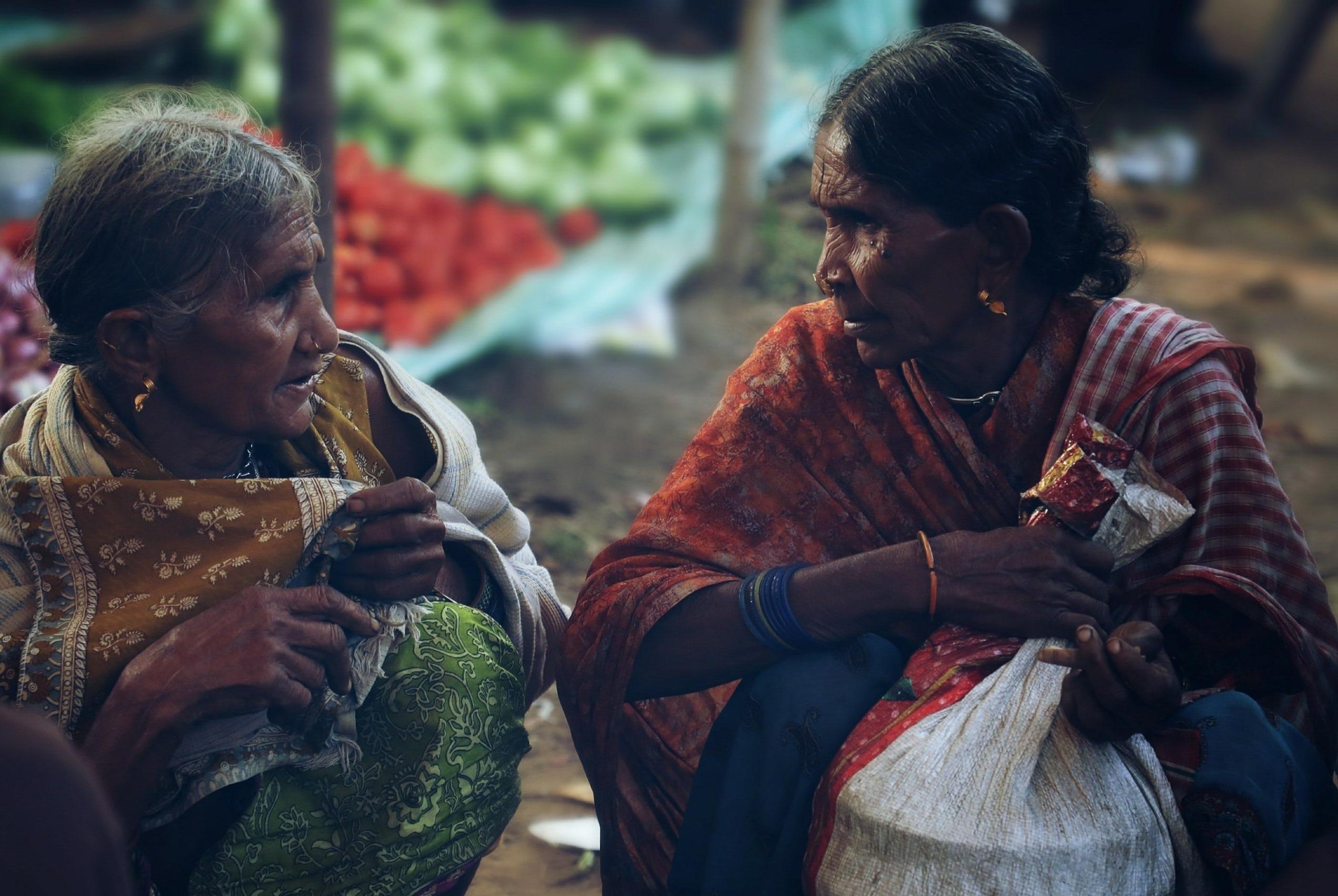 Photo of two elderly women talking
