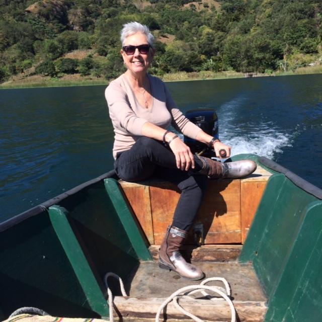 Debra L. Gish drives her handmade boat across Lake Atitlán.
